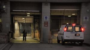 Baltimore Police transfer van pulls into Baltimore Central Booking and Intake Center.  (Karl Merton Ferron / Baltimore Sun)