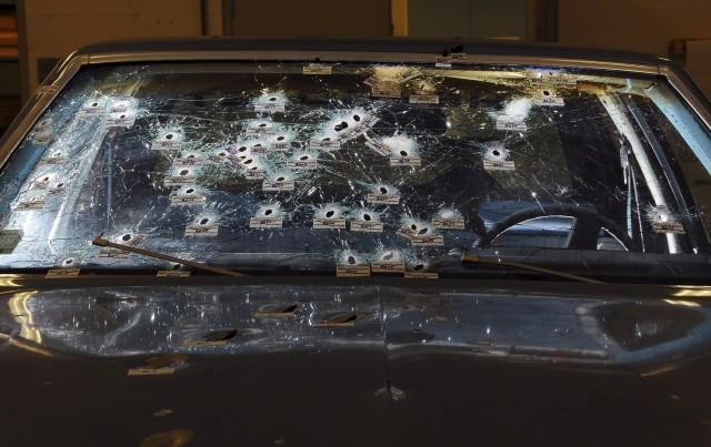 A 2012 forensics photo shows bullet holes in the Chevrolet Malibu in Brelo's case. (Ohio Attorney General's Office via Associated Press)